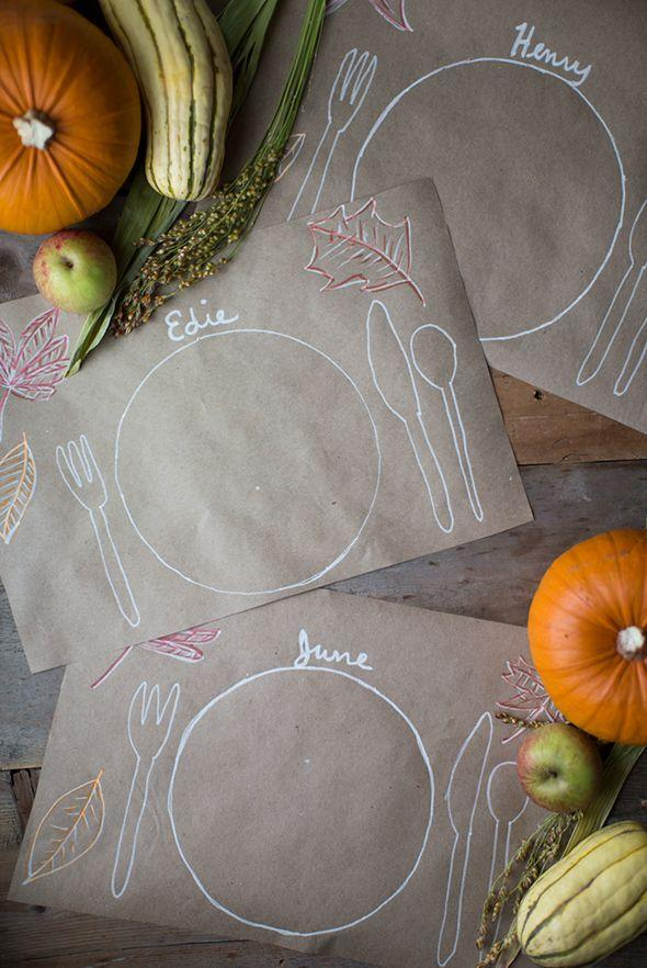 """<p>These <a href=""""https://www.countryliving.com/entertaining/g634/thanksgiving-table-settings-1108/"""" rel=""""nofollow noopener"""" target=""""_blank"""" data-ylk=""""slk:crafty Thanksgiving placemats"""" class=""""link rapid-noclick-resp"""">crafty Thanksgiving placemats</a> double as name cards—and just might inspire an impromptu art party! Don't forget the chalkboard marker.</p><p><strong>Get the tutorial at </strong><strong><a href=""""http://sayyes.com/2015/10/the-thanksgiving-kids-table.html"""" rel=""""nofollow noopener"""" target=""""_blank"""" data-ylk=""""slk:Say Yes"""" class=""""link rapid-noclick-resp"""">Say Yes</a>.</strong></p><p><a class=""""link rapid-noclick-resp"""" href=""""https://www.amazon.com/Paper-Wrapping-Shipping-Covering-Recycled/dp/B0788YRV9V/?tag=syn-yahoo-20&ascsubtag=%5Bartid%7C10050.g.1201%5Bsrc%7Cyahoo-us"""" rel=""""nofollow noopener"""" target=""""_blank"""" data-ylk=""""slk:SHOP CRAFT PAPER"""">SHOP CRAFT PAPER</a><br></p>"""