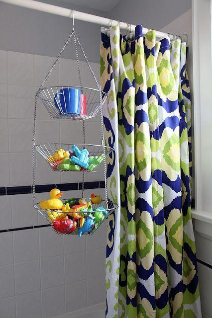 """<p>Get three levels of storage in your shower (without gross water pooling on shelves) by repurposing a tiered hanging basket for toiletries and bath toys.</p><p><a href=""""http://8footsix.com/2011/07/bathroom-makeover-before-after.html"""" rel=""""nofollow noopener"""" target=""""_blank"""" data-ylk=""""slk:See more at 8 Foot Six »"""" class=""""link rapid-noclick-resp""""><em>See more at 8 Foot Six »</em></a></p>"""