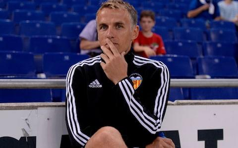 Phil Neville was once assistant coach of Valencia - Credit: AFP