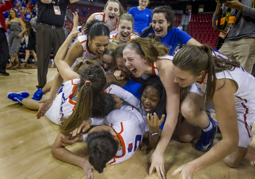 Boise State players pile up on each other in celebration of their 62-60 win over Nevada in the NCAA college basketball game in the championship of the Mountain West Conference tournament Friday, March 9, 2018, in Las Vegas. (AP Photo/L.E. Baskow)