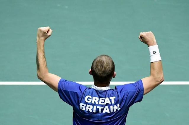 Great Britain's Daniel Evans celebrates after winning his David Cup quarter-final rubber (AFP Photo/JAVIER SORIANO)