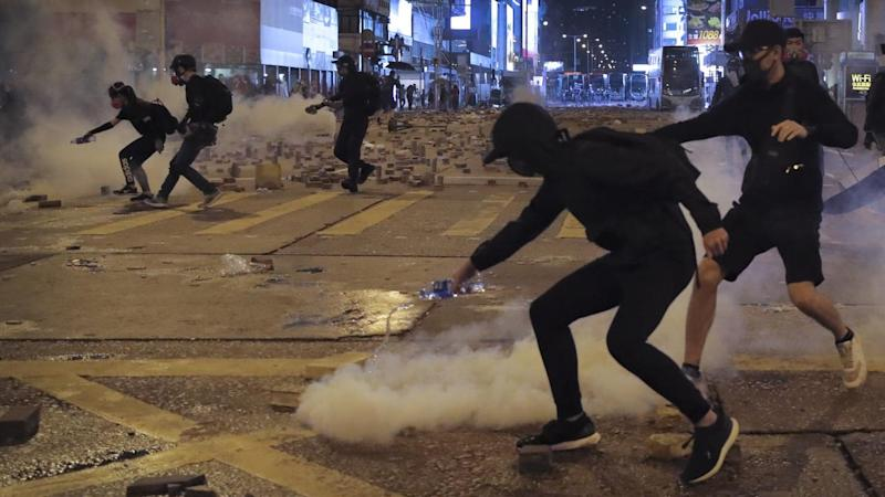 A protester was shot and a man set on fire in some of worst violence to rock the Hong Kong protests