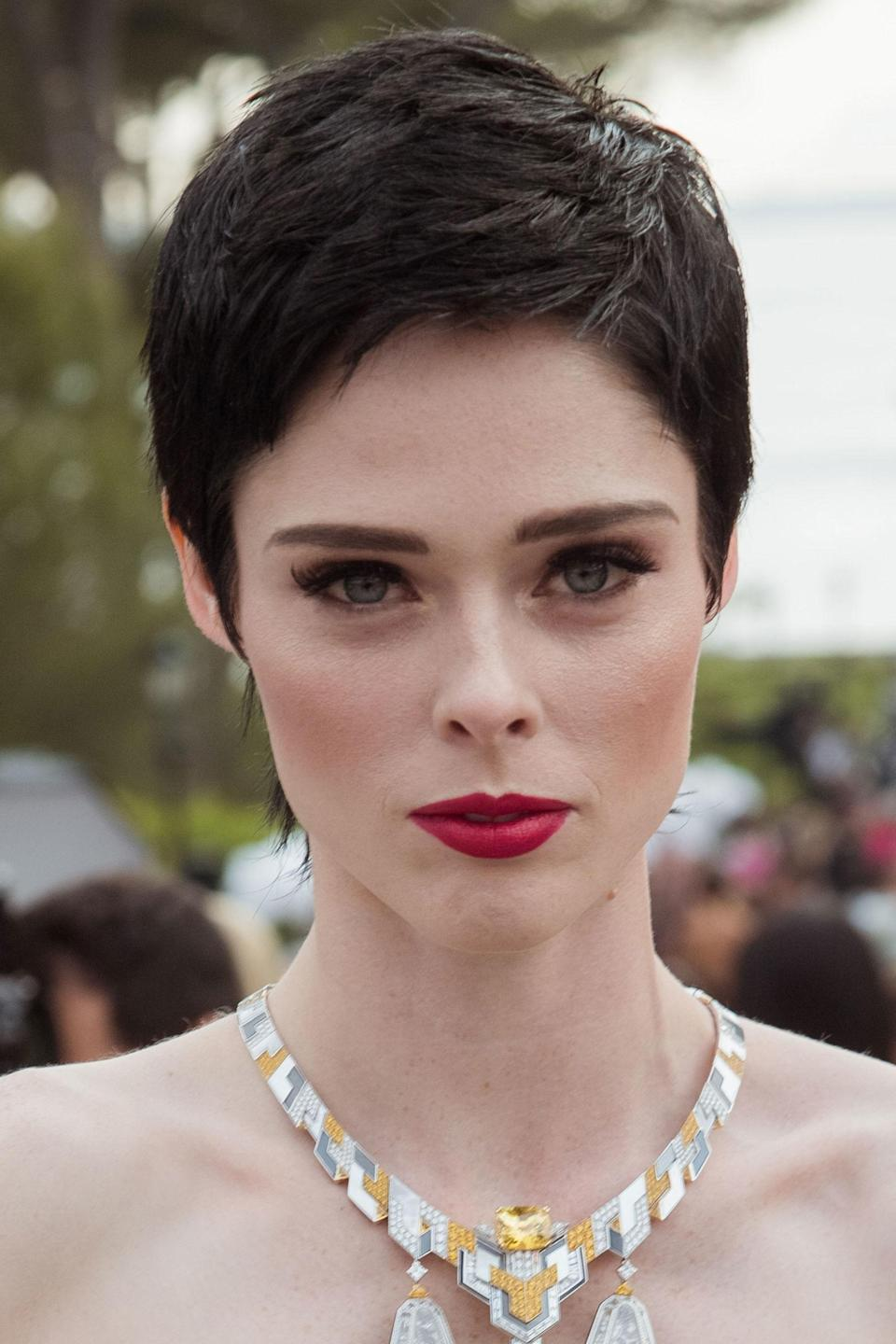 <p>In a drastic move, Rocha dyed her platinum blonde locks a deep chocolate brown hue and chopping into a pixie cut which she styled with a smoky eye and red lip. </p>