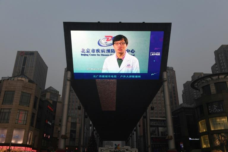 China's state media has heralded the importance of patriotism in tackling the coronavirus outbreak in a campaign reminiscent of Chairman Mao's cries to mobilise the masses (AFP Photo/GREG BAKER)