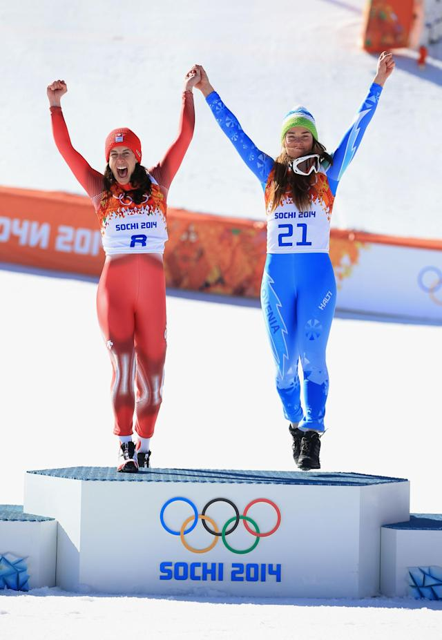 SOCHI, RUSSIA - FEBRUARY 12: Gold medalists Dominique Gisin of Switzerland (L) and Tina Maze of Slovenia celebrate on the podium during the flower ceremony for during the Alpine Skiing Women's Downhill on day 5 of the Sochi 2014 Winter Olympics at Rosa Khutor Alpine Center on February 12, 2014 in Sochi, Russia. (Photo by Richard Heathcote/Getty Images)