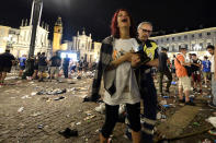 <p>Juventus supporters evacuate Piazza San Carlo after a panic movement in the fanzone where thousands of Juventus fans were watching the UEFA Champions League Final football match between Juventus and Real Madrid on a giant screen, on June 3, 2017 in Turin. (Massimo Pinca/AFP/Getty Images) </p>