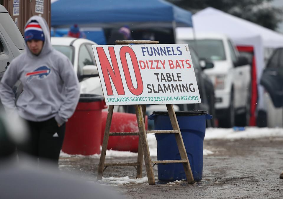 A sign notes the prohibition of table slamming and other activities as fans of the Buffalo Bills gather for tailgating activities in 2018.