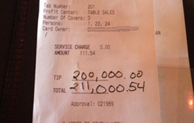 Customer gives this receipt to server in a US restaurant, stating that a US$200,000 tip to be included in the bill. Yahoo Newsroom - Receipt photo courtesy of Reddit.