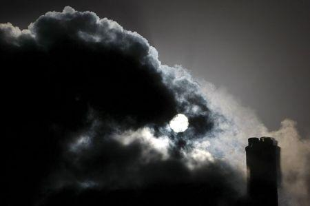 File picture of the sun seen through the steam and other emissions coming from funnels of the brown coal Loy Yang Power Station in the Latrobe Valley near Melbourne