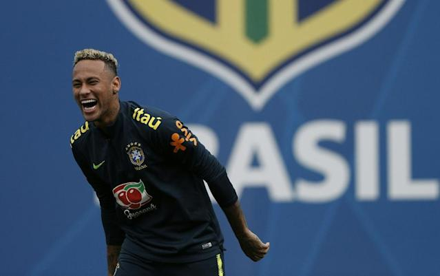 A giant sigh of relief came in Brazil when pictures emerged of Neymar's newly shorn head (AFP Photo/Adrian DENNIS)