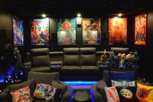 The home cinema decorated with posters, plush toys and statues. Photo: Helmi Abdat