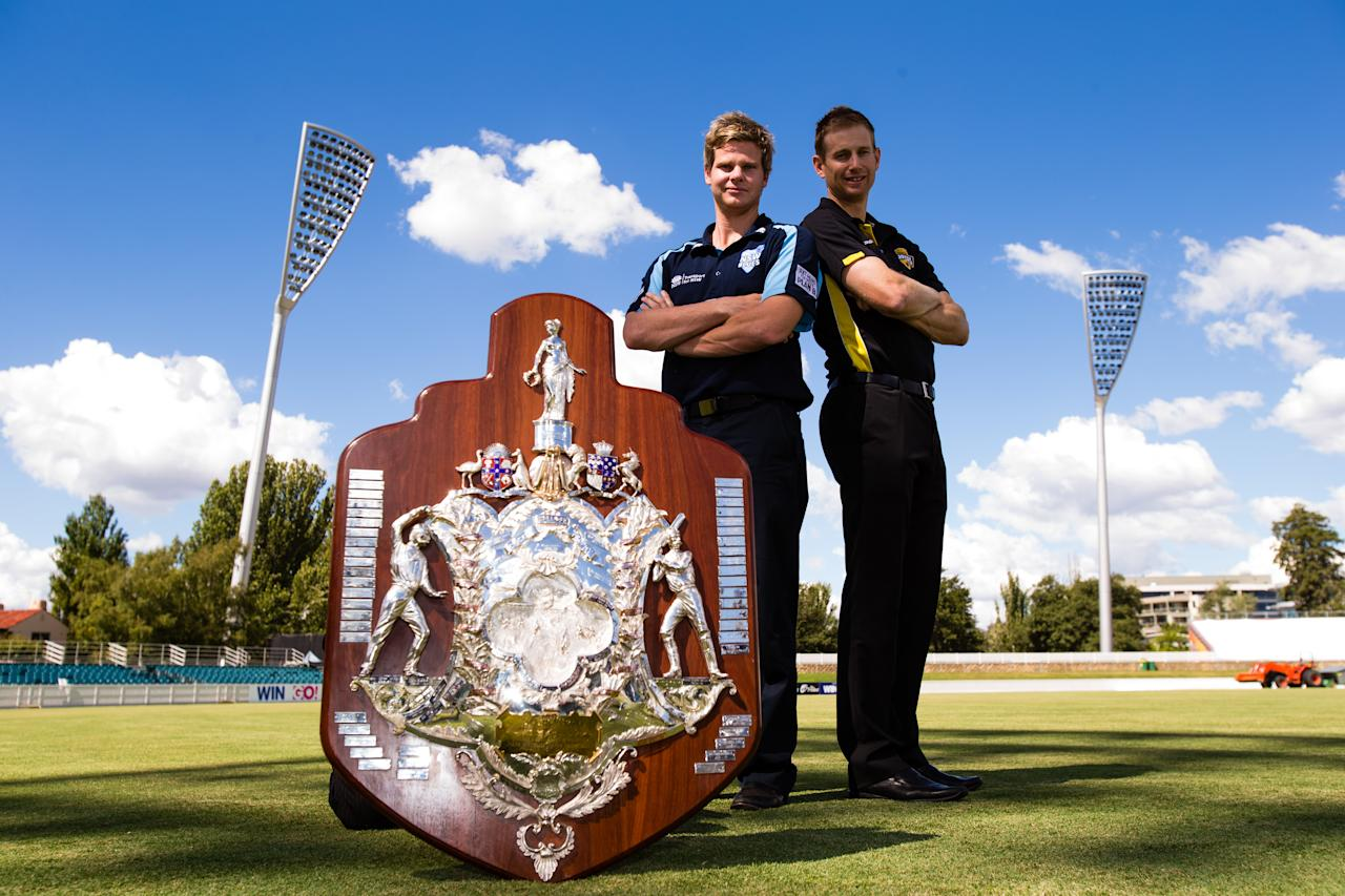 CANBERRA, AUSTRALIA - MARCH 19: NSW captain Steve Smith and WA captain Adam Voges pose with the Sheffield Sheild after the Cricket Australia State Awards at Manuka Oval on March 19, 2014 in Canberra, Australia.  (Photo by Mark Nolan/Getty Images)