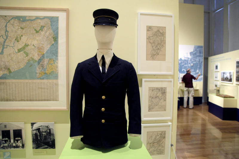 """In this Thursday, Sept. 13, 2012 photo, an early 20th century uniform worn by a Staten Island Rapid Transit operator is displayed at the exhibit """"From Farm to City: Staten Island 1661-2012"""" at the City of New York Museum in New York. It is known as New York City's greenest borough _ and also as its forgotten borough. Aside from the Staten Island Ferry, the Verrazzano Bridge and maybe the Fresh Kills landfill, few people know anything about Staten Island and its rich history and influence on the development of the rest of the city. Now, this new exhibition aims to rectify that. (AP Photo/Seth Wenig)"""