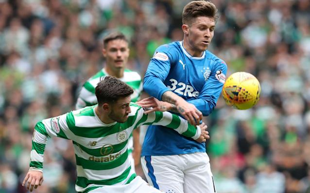 Celtic's Patrick Roberts was on song early in the match. Here he is battling Rangers' Josh Windass - PA