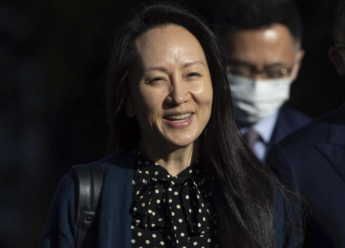 Meng Wanzhou, chief financial officer of Huawei, smiles as she leaves her home in Vancouver on Friday, Sept. 24, 2021. (Darryl Dyck/The Canadian Press via AP)