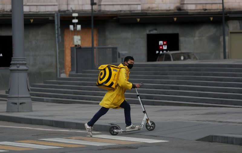 FILE PHOTO: A Yandex.Eats food delivery courier rides a scooter in Moscow