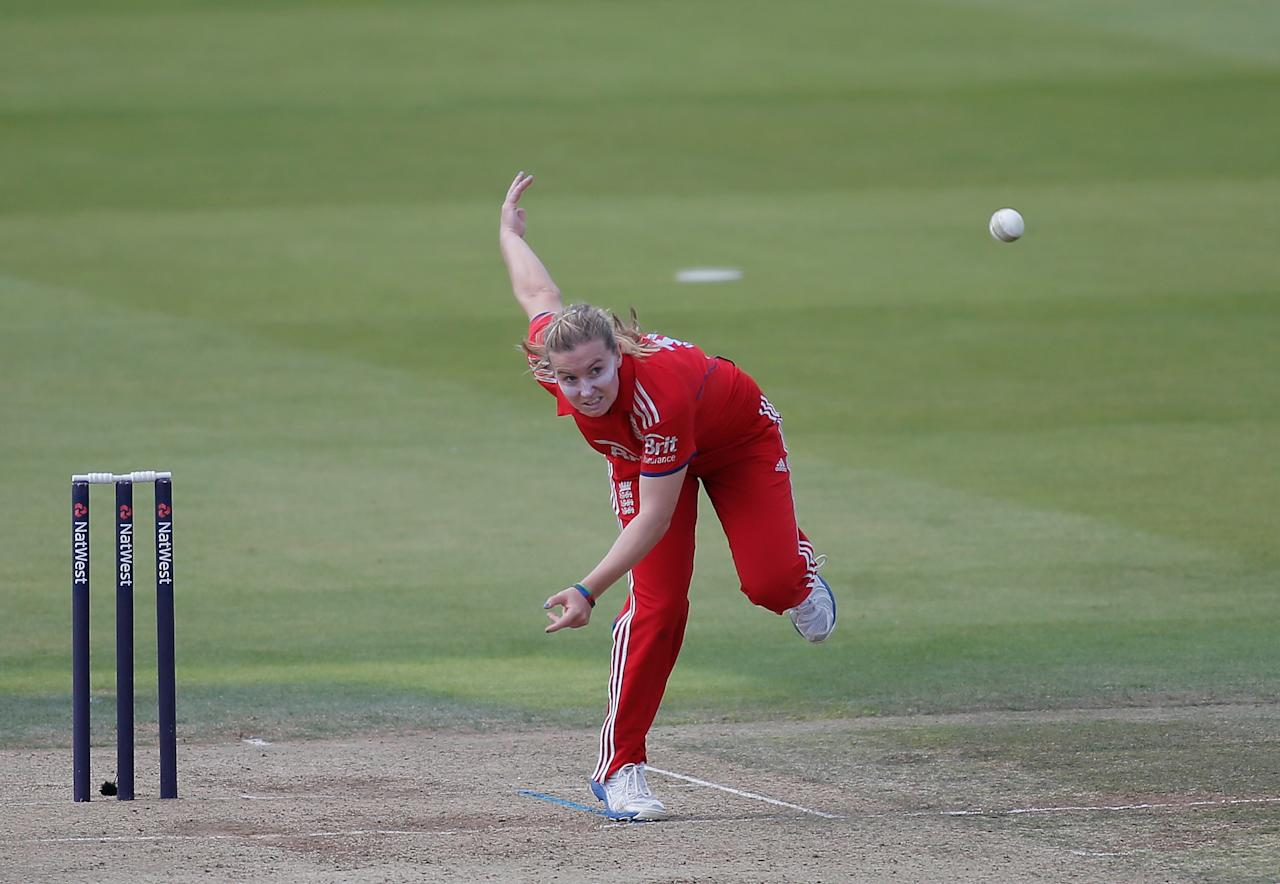 LONDON, ENGLAND - AUGUST 20:  Holly Colvin of England bowls during the first NatWest One Day International match between England and Australia at Lord's Cricket Ground on August 20, 2013 in London, England.  (Photo by Harry Engels/Getty Images)