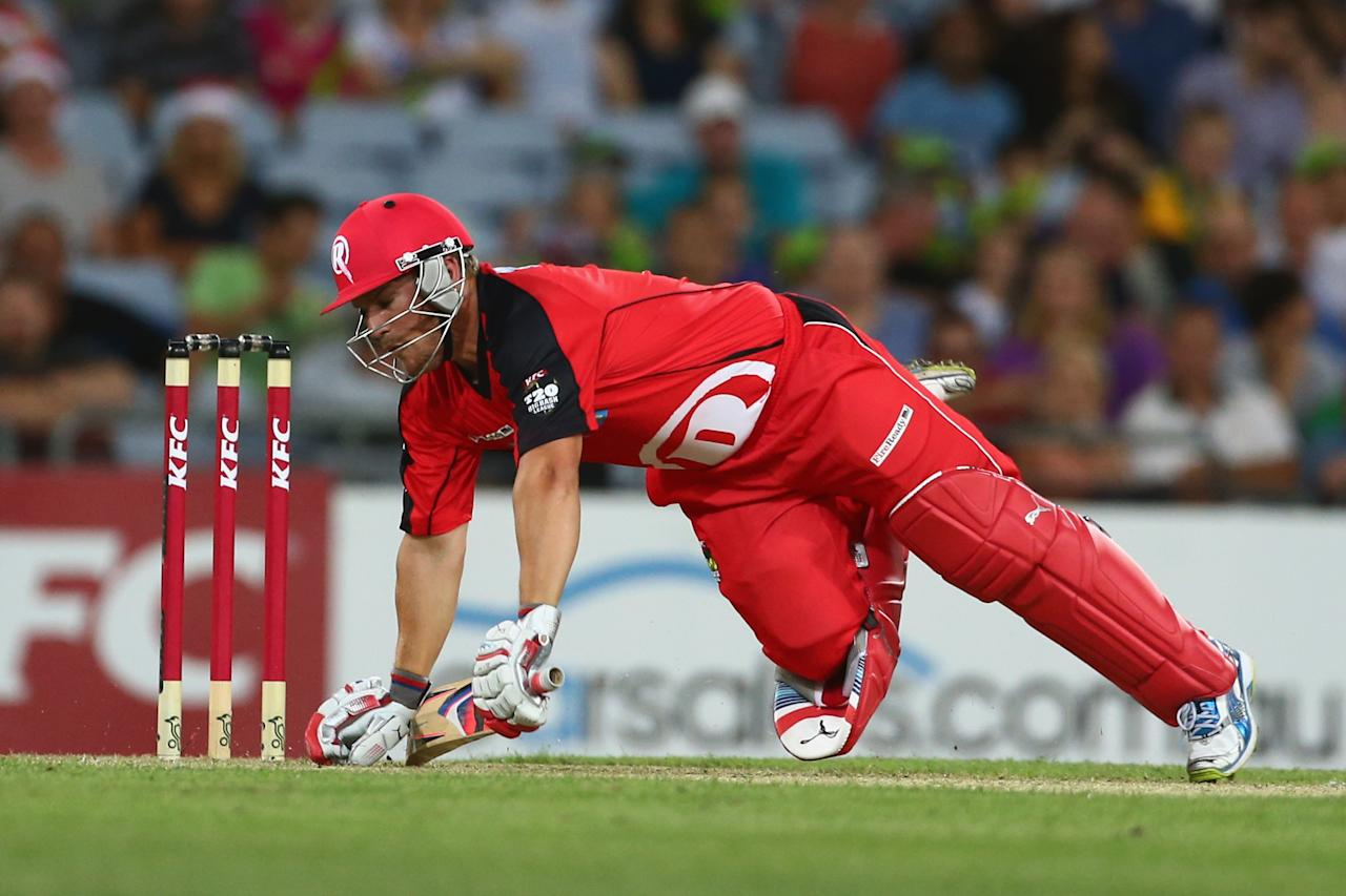 SYDNEY, AUSTRALIA - DECEMBER 14:  Aaron Finch of the Renegades falls over as he bats during the Big Bash League match between the Sydney Thunder and the Melbourne Renegades at ANZ Stadium on December 14, 2012 in Sydney, Australia.  (Photo by Mark Kolbe/Getty Images)