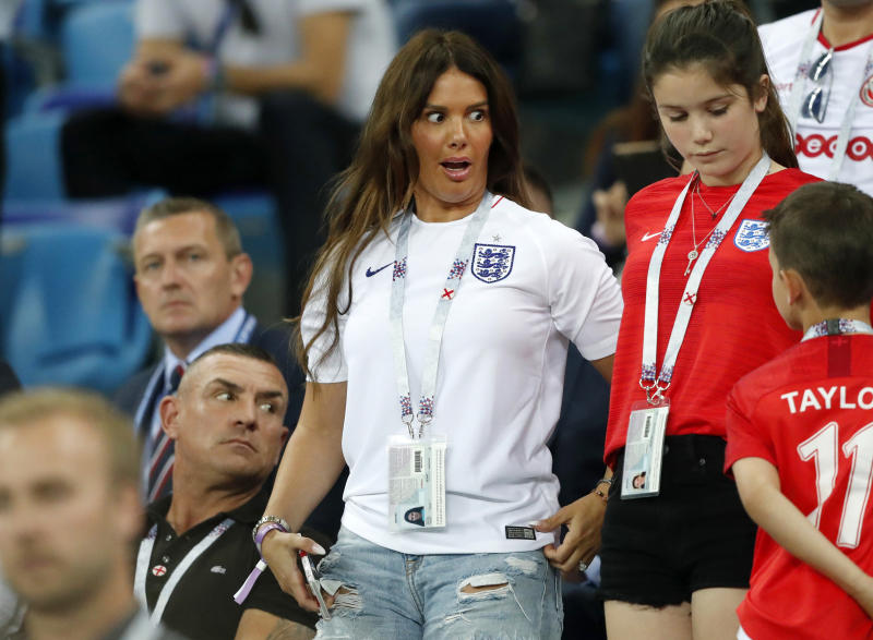 FILE - In this file photo dated Monday, June 18, 2018, Rebekah Vardy, wife of England's forward Jamie Vardy, reacts on the tribune during a 2018 soccer World Cup match between Tunisia and England in Volgograd, Russia. The wives of two of English soccer's most high-profile players are involved in a spat, Wednesday Oct. 9, 2019, as Wayne Rooney's wife, Coleen, has accused Jamie Vardy's wife, Rebekah, of leaking her private Instagram information to a tabloid newspaper. Vardy denies the allegations. (AP Photo/Frank Augstein, FILE)