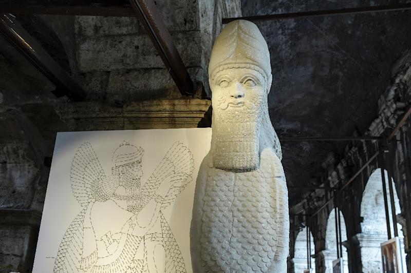 A full-scale reproduction shows the human-headed bull from the north-west palace in Nimrud, Iraq presented at an exhibition at the ancient Colosseum in Rome on October 6, 2016