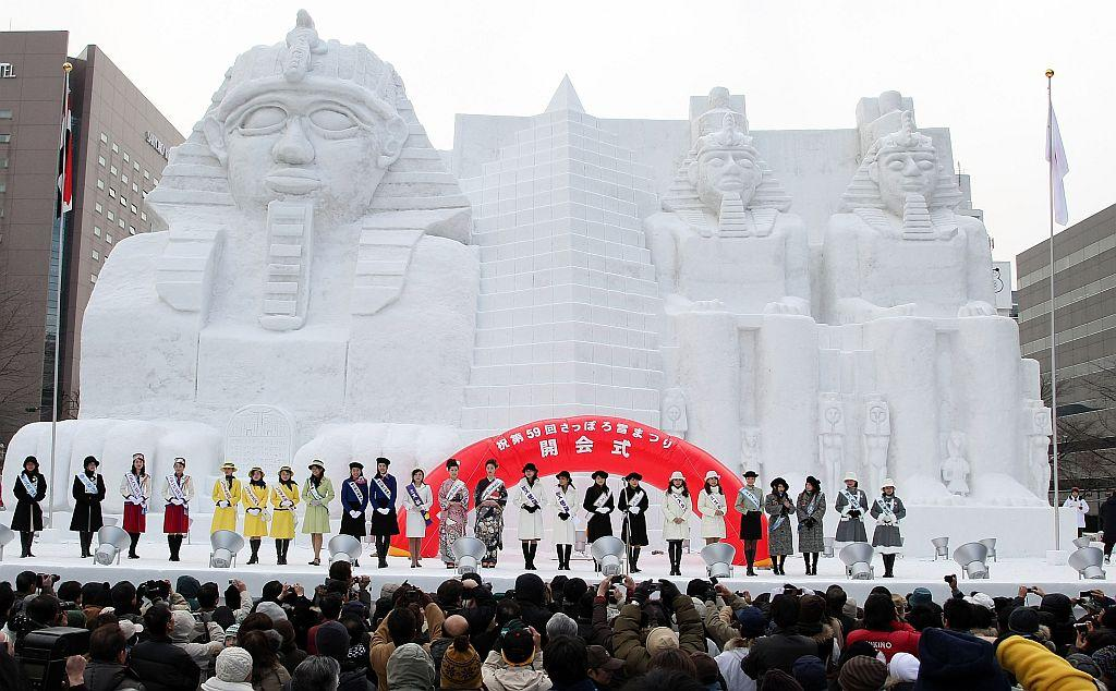 Miss Japan contestants attend the opening ceremony of the Snow Festival in Odori Park.