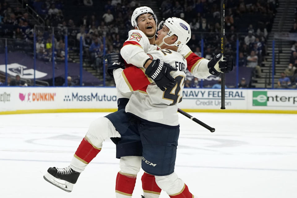 Florida Panthers defenseman Gustav Forsling (42) celebrates his goal against the Tampa Bay Lightning with defenseman Brandon Montour (62) during the third period in Game 3 of an NHL hockey Stanley Cup first-round playoff series Thursday, May 20, 2021, in Tampa, Fla. (AP Photo/Chris O'Meara)
