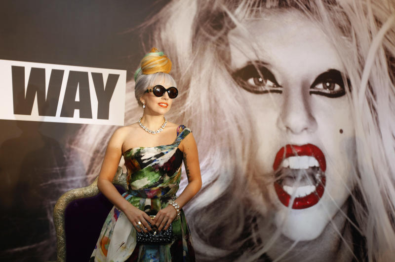US singer Lady Gaga pose for the media during a press conference in New Delhi, India, Friday, Oct. 28, 2011. (AP Photo/Mustafa Quraishi)
