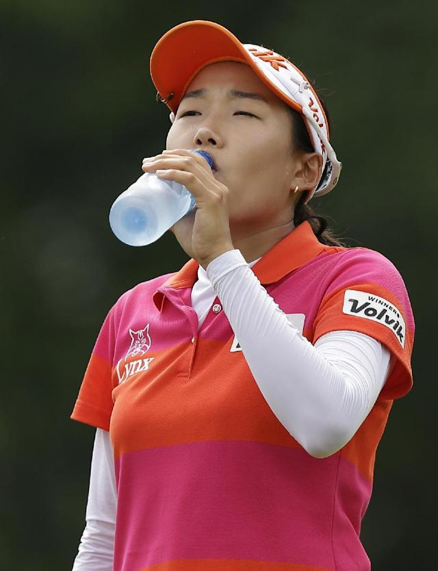 Korea's Ilhee Lee takes a drink of water during her second round at the Malaysian LGPA event in Kuala Lumpur, Friday, Oct. 11, 2013. (AP Photo/Mark Baker)
