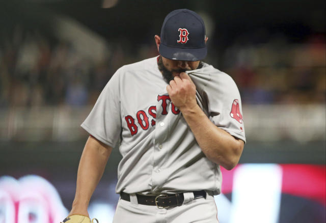 Boston Red Sox pitcher Robby Scott leaves in the eighth inning of the team's baseball game against the Minnesota Twins on Tuesday, June 19, 2018, in Minneapolis. The Twins won 6-2. Scott took the loss. (AP Photo/Jim Mone)