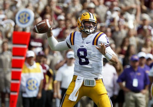 LSU quarterback Zach Mettenberger (8) throws against Texas A&M during the first half of an NCAA college football game, Saturday, Oct. 20, 2012, in College Station, Texas. (AP Photo/Eric Kayne)