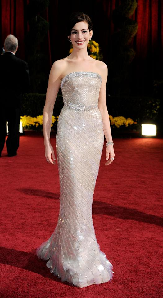 <p>A statuesque Anne Hathaway shone like a pearl in a Giorgio Armani shoulderless gown for the ages. <i>(Getty)</i> </p>