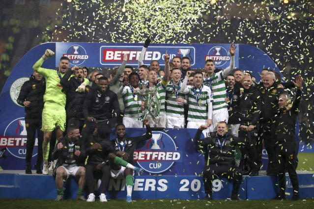 Celtic celebrate with the trophy after the Scottish Cup soccer Final between Celtic and Rangers at Hampden Park, Glasgow, Scotland, Sunday, Dec. 8, 2019. (Jeff Holmes/PA via AP)