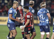Blues Rieko Ioane, left, and Crusaders Richie Mo'unga shake hands following the Super Rugby Aotearoa rugby game between the Crusaders and the Blues in Christchurch, New Zealand, Saturday, July 11, 2020. (AP Photo/Mark Baker)