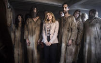 """This image released by CBS shows Rose McIver, center, in a scene from the comedy series """"Ghosts."""" (CBS via AP)"""