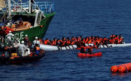 Rescue NGOs Sea-Eye and the Migrant Offshore Aid Station (MOAS) carry out a joint rescue operation as some 20 migrants on a rubber dinghy drowned in the central Mediterranean in international waters off the coast of Libya