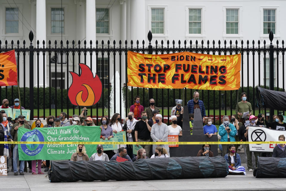 Protesters gather to call on the Biden administration to do more to combat climate change and ban fossil fuels outside the White House in Washington, Tuesday, Oct. 12, 2021. (AP Photo/Patrick Semansky)