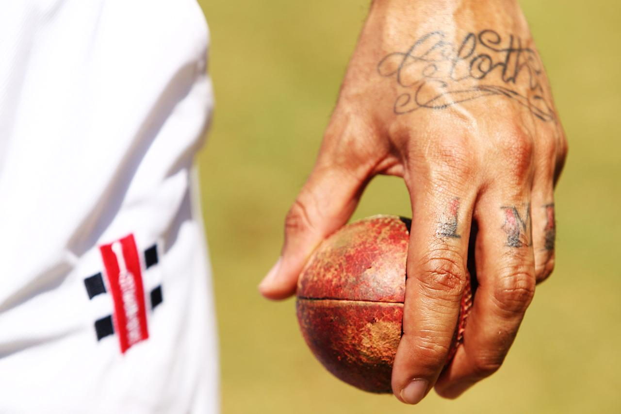 SYDNEY, AUSTRALIA - FEBRUARY 01:  Isaac Hayes of the Homies & the POPz tattoos are seen during a Twenty20 match between Sydney University and Compton Cricket Club at Sydney University cricket oval No. 2 on February 1, 2011 in Sydney, Australia. The team, comprised of African Americans and Latinos from Compton, a city notorious for gang violence, was formed to find an alternative to the gang lifestyle. The team will be in Australia for two weeks, playing matches in Sydney, and Melbourne and participating in fundraising events to support Australian flood victims.  (Photo by Brendon Thorne/Getty Images)