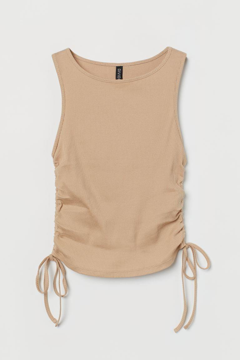 <p>This <span>Drawstring Tank Top</span> ($13) will look sophisticated with trousers and some low-heeled sandals.</p>