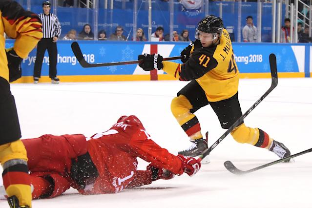 <p>Jonas Muller #41 of Germany shoots and scores a goal in the third period against Olympic Athletes from Russia during the Men's Gold Medal Game on day sixteen of the PyeongChang 2018 Winter Olympic Games at Gangneung Hockey Centre on February 25, 2018 in Gangneung, South Korea. (Photo by Bruce Bennett/Getty Images) </p>