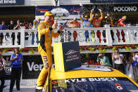 Kyle Busch celebrates with teammates after winning a NASCAR Cup Series auto race at Pocono Raceway, Sunday, June 27, 2021, in Long Pond, Pa. (AP Photo/Matt Slocum)