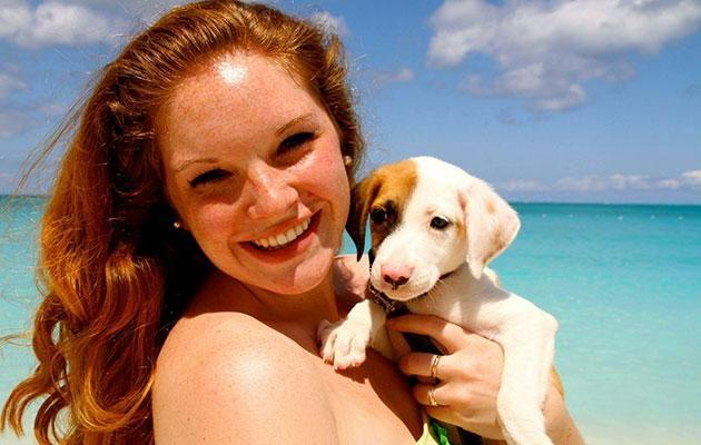 Potcake Place lets Island visitors cuddle puppies. Photo: Facebook
