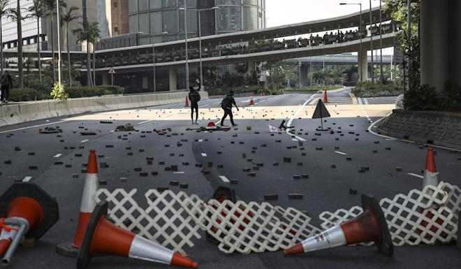 Protesters scatter bricks on a road in Central. Photo: Winson Wong