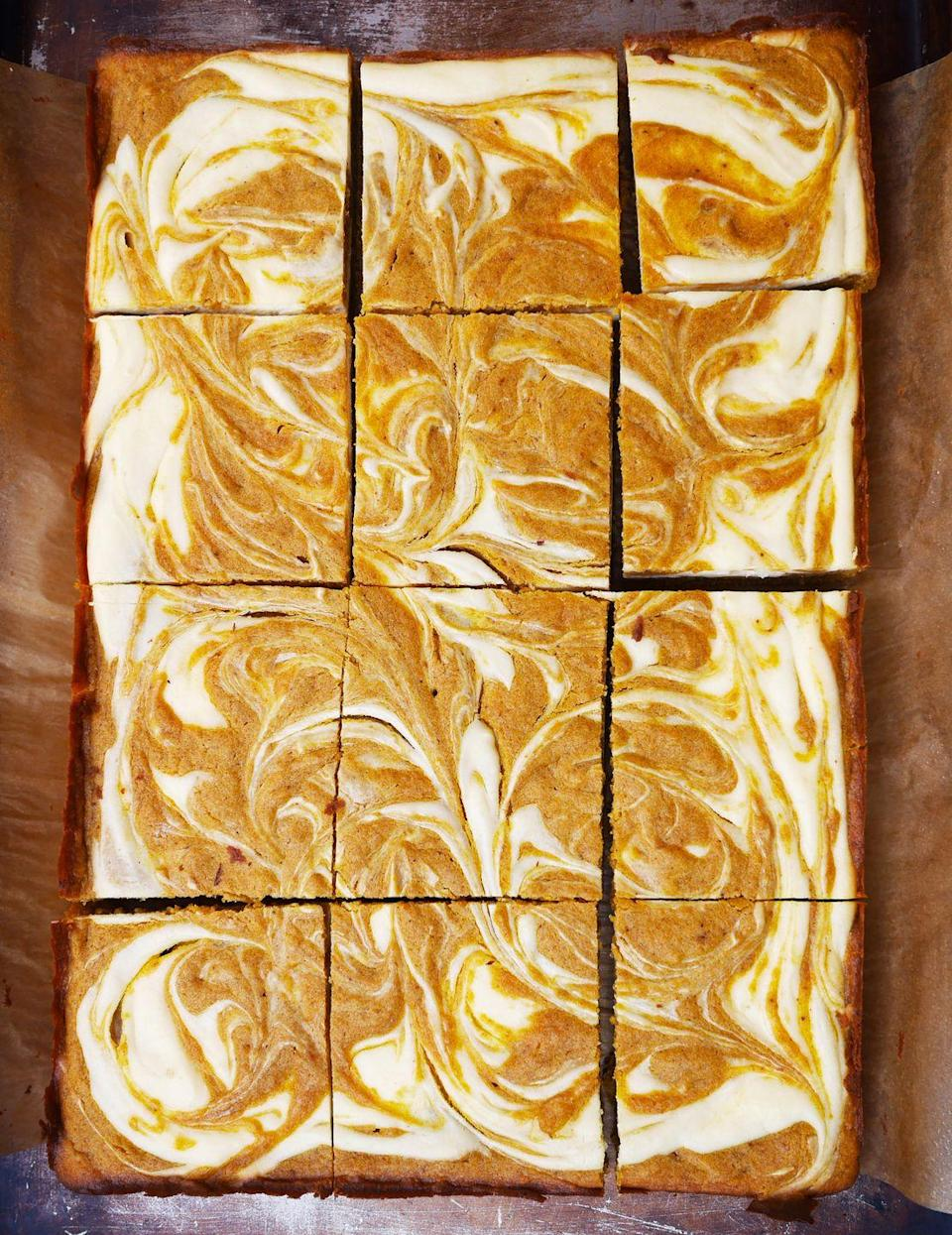 """<p>The pumpkin cheesecake swirls on these blondies are mesmerizing.</p><p>Get the recipe from <a href=""""https://www.delish.com/cooking/recipe-ideas/recipes/a48964/pumpkin-spice-blondies-with-cheesecake-swirl-recipe/"""" rel=""""nofollow noopener"""" target=""""_blank"""" data-ylk=""""slk:Delish"""" class=""""link rapid-noclick-resp"""">Delish</a>.</p>"""