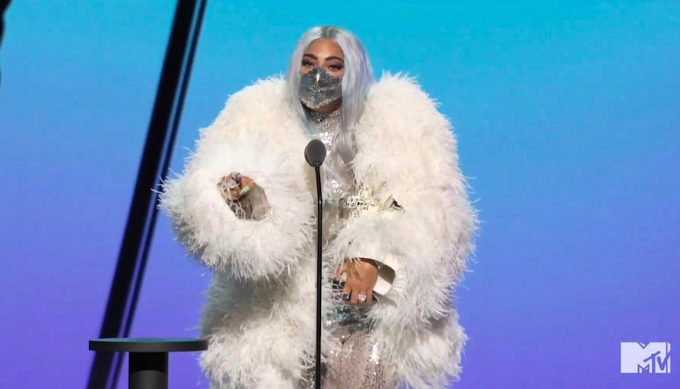 Lady Gaga accepts the award for artist of the year.