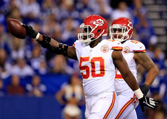 INDIANAPOLIS, IN - JANUARY 04: Outside linebacker Justin Houston #50 of the Kansas City Chiefs celebrates against the Indianapolis Colts during a Wild Card Playoff game at Lucas Oil Stadium on January 4, 2014 in Indianapolis, Indiana. (Photo by Rob Carr/Getty Images)
