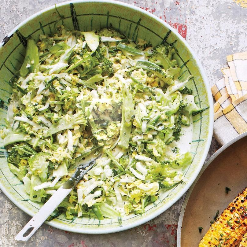 "Chop broccoli and napa cabbage together and what do you have? The crunchiest, greenest summer slaw we could think of. Add chives and snap peas for extra liveliness. <a href=""https://www.epicurious.com/recipes/food/views/creamy-summer-slaw-51178860?mbid=synd_yahoo_rss"" rel=""nofollow noopener"" target=""_blank"" data-ylk=""slk:See recipe."" class=""link rapid-noclick-resp"">See recipe.</a>"