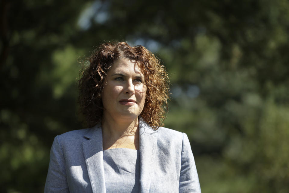FILE - Mary Pat Carl poses for a photo Tuesday, July 28, 2020, in St. Louis. Carl is challenging incumbent Kim Gardner in the Tuesday, Aug 4, 2020 Democratic primary for St. Louis circuit attorney. (AP Photo/Jeff Roberson)