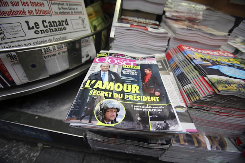 """The French magazine Closer with photos of French President Francois Hollande and French actress Julie Gayet on its front page, is presented in a newspaper stall on the Champs Elysee Avenue in Paris, Friday Jan. 10, 2013. French President Francois Hollande is threatening legal action over the magazine report saying he is having a secret affair with the French actress Julie Gayet. Hollande, in a statement obtained by The Associated Press, says he """"deeply deplores the attacks on respect for privacy, to which each citizen has a right."""" .(AP Photo/Remy de la Mauviniere)"""