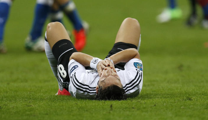 Germany's Mesut Oezil reacts after losing the Euro 2012 soccer championship semifinal match between Germany and Italy in Warsaw, Poland, Thursday, June 28, 2012. (AP Photo/Matthias Schrader)