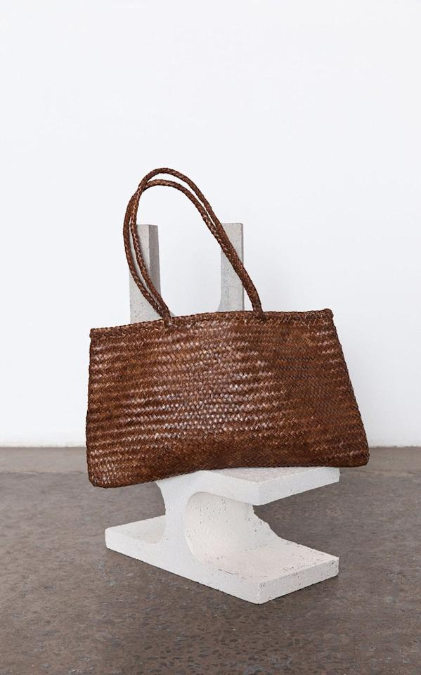 "<p>You can't go wrong with this roomy <product href=""https://www.modaoperandi.com/st-agni-r21/large-bagu-woven-leather-tote?size=OS#zoom"" target=""_blank"" class=""ga-track"" data-ga-category=""Related"" data-ga-label=""https://www.modaoperandi.com/st-agni-r21/large-bagu-woven-leather-tote?size=OS#zoom"" data-ga-action=""In-Line Links"">St. Agni Large Bagu Woven Leather Tote</product> ($365).</p>"